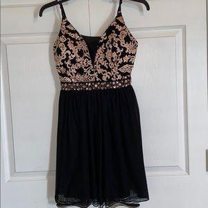 Black and rose gold midi dress.